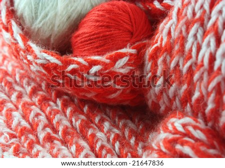 Two balls of a wool yarn in a scarf - stock photo