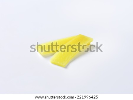 two bamboo shoot slices on white background