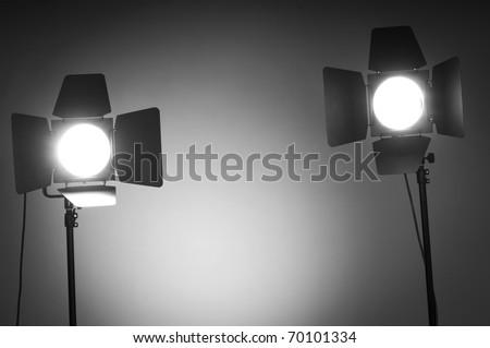 Two barn door lights in photo studio - stock photo