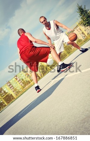 Two basketball players on the court - stock photo