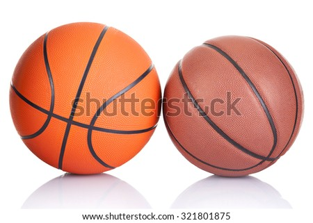 Two basketballs isolated on a white background - stock photo