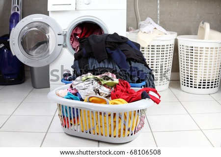 Two baskets of dirty laundry in the washing room - stock photo