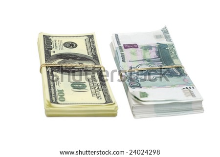 two batches of false 100 dollar bills and false 1000 rubble bills tied with rubber bands side by side against white background
