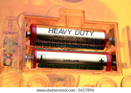 Two batteries in compartment - stock photo
