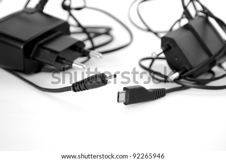 Two battery chargers with different kind of plugs - stock photo