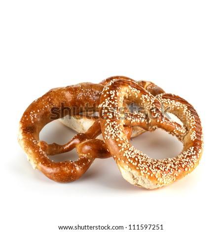 Two Bavarian soft pretzels, isolated on white. - stock photo