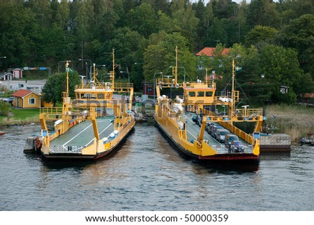 Two Bay Ferries Transporting Cars, Traffic - stock photo
