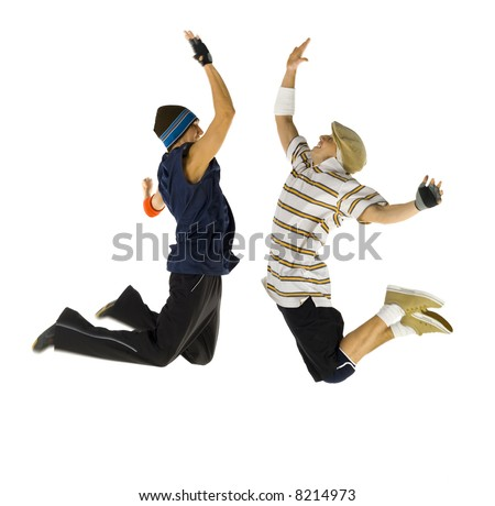 Two bboys freezed in jump. Trying to give high five. Isolated on white in studio. Side view, whole body