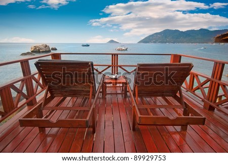 Two beach beds on a terrace with beautiful sea view