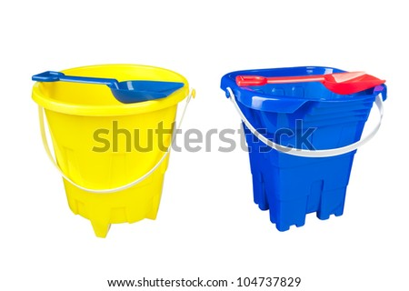 Two beach bucket and shovel toys isolated on a white background for use as a design element or as it.
