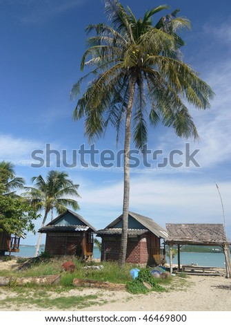 Two beach cabins at a tropical beach