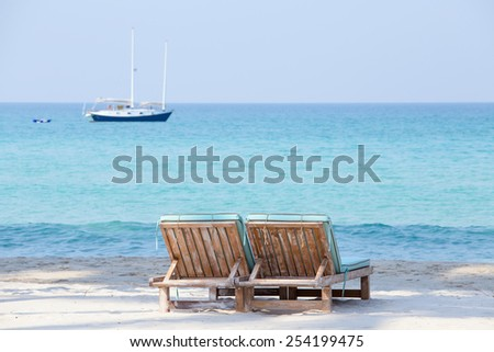 Two beach chairs and beautiful sand beach - stock photo