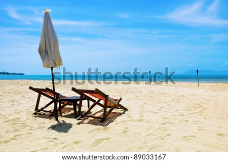 Two beach chairs on a tropical beach, - stock photo