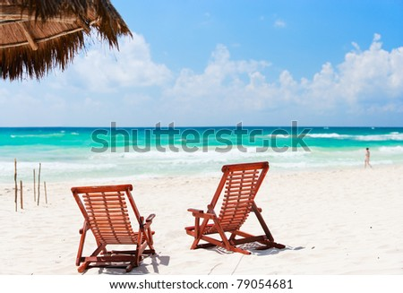 Two beach chairs on beautiful Caribbean coast - stock photo