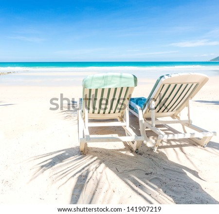 Two beach chairs on perfect tropical white sand beach