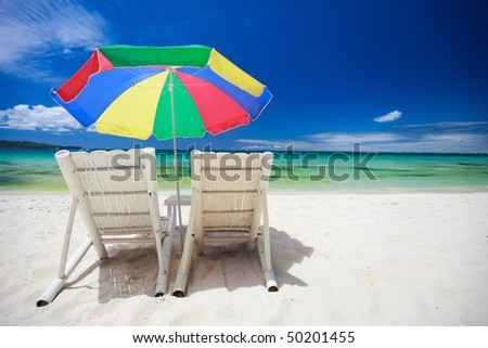 Two beach chairs on perfect tropical white sand beach in Boracay, Philippines