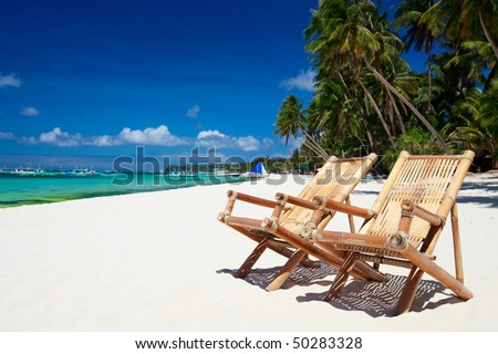Two beach chairs on perfect tropical white sand beach in Boracay, Philippines - stock photo