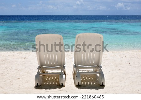 Two beach chairs on the beach. - stock photo