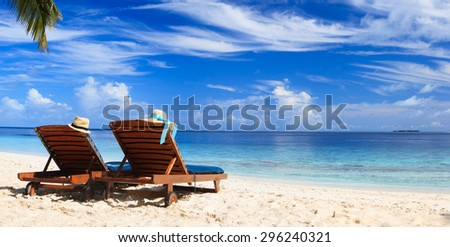 Two beach chairs on the tropical sand beach - stock photo