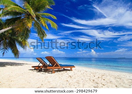 Two beach chairs on the tropical sand beach