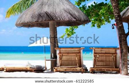 Two beach chairs on tropical coast in Philippines - stock photo