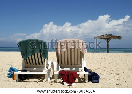 Two beach seats at a resort in Cuba