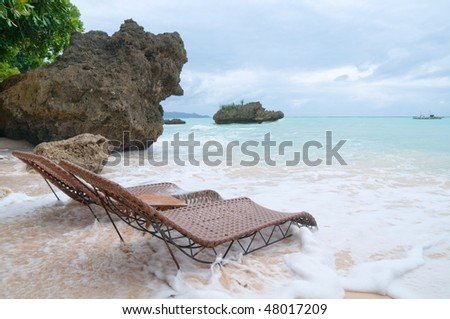 Two beachbeds on the seashore in stormy weather, Philippines - stock photo