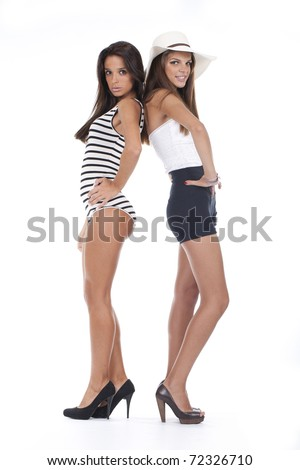 two beautiful and handsome women standing and posing - stock photo