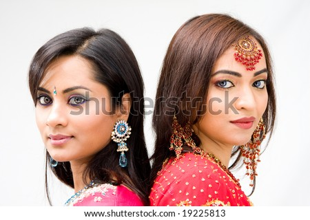 Two beautiful Bengali brides in colorful dresses, isolated - stock photo
