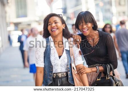 Two Beautiful Black Woman Walking in New York - stock photo