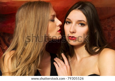 Two beautiful blonde and brunette - stock photo