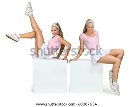 Two Beautiful blondie girls doing sport exercises - stock photo