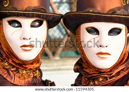 Two beautiful brown mask in Venice, Italy. - stock photo