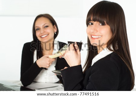 two beautiful business women sitting at the table