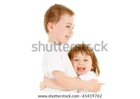Two beautiful Caucasian children, a boy and a girl, hugging each other with happy smiling facial expression. Image isolated on white studio background.
