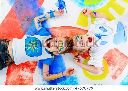 Two beautiful children enjoying their painting. Education. - stock photo