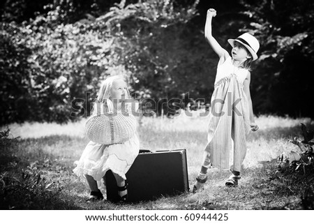 Two beautiful children walking together. Retro style. - stock photo