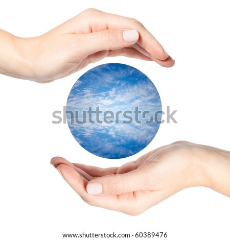 Two beautiful female hands surrounding a sphere of water and clouds - stock photo