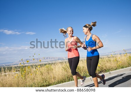 Two Beautiful Female Joggers - stock photo