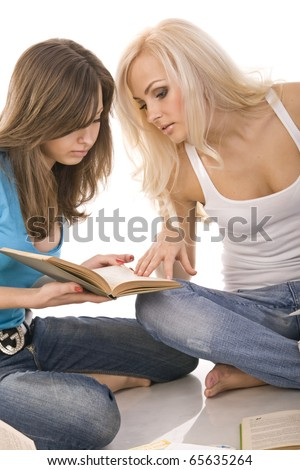 two beautiful girl thoughtfully reading a book, surrounded by books