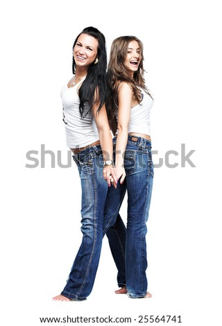 two beautiful girlfriends in blue jeans on white
