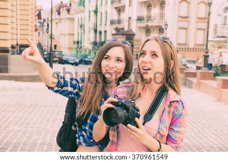 Two beautiful girlfriends with the camera to the tour