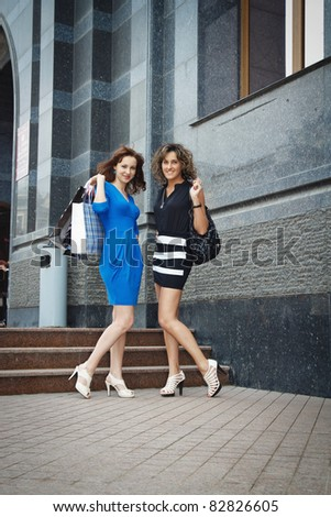 two beautiful girls are happy buying - stock photo