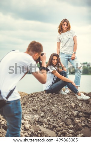 two beautiful girls at a photo shoot