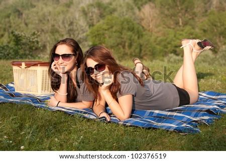 two beautiful girls at a picnic - stock photo