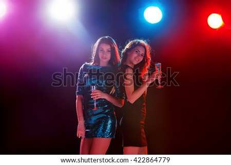 Two beautiful girls dancing at the party