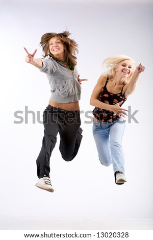 Two beautiful girls in jumping and showing nobody...