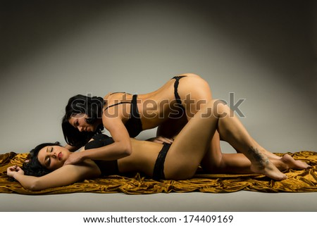 two beautiful girls with perfect bodies posing in lingerie - stock photo