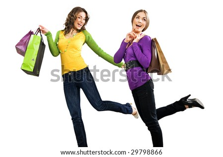Two beautiful girls with shoppingbags isolated on white - stock photo