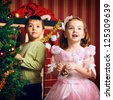 two beautiful happy child decorate christmas tree - stock photo